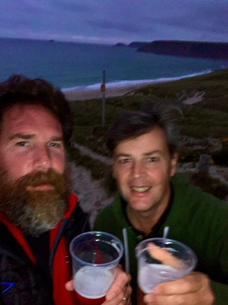 Gavin and myself with a glass of beer with Sennen Cove in the background