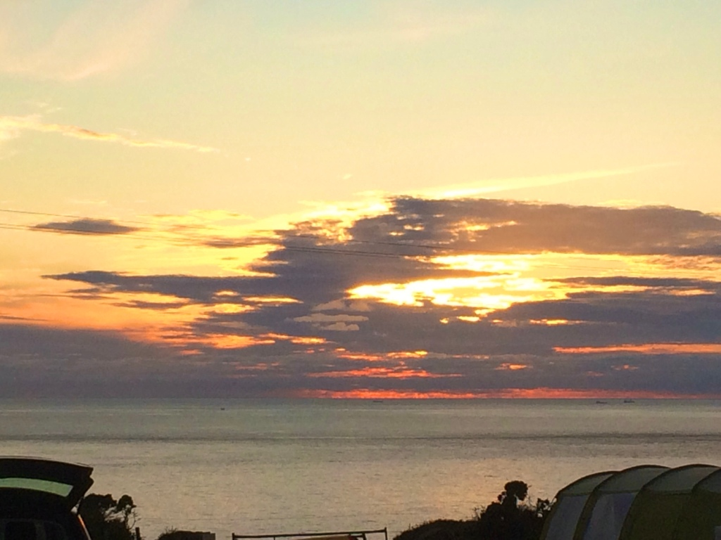 The sunset over the Atlantic Ocean taken from our camping pitch